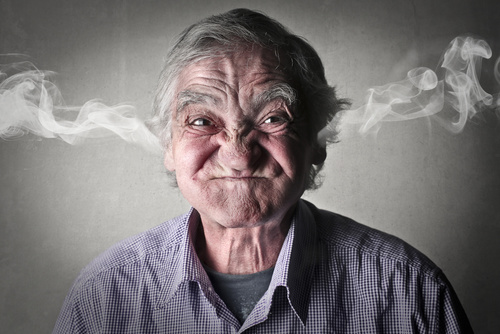 Is workplace anger making life miserable: An elderly man who looks angry, with steam coming out of his ears