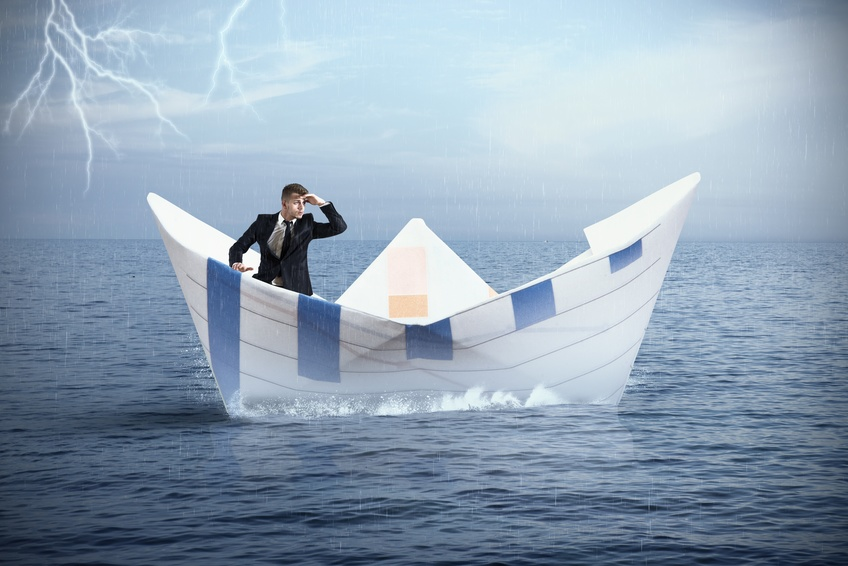 Shape Up or Ship Out of HR-or Business: Businessman escapes from the crisis on a paper boat