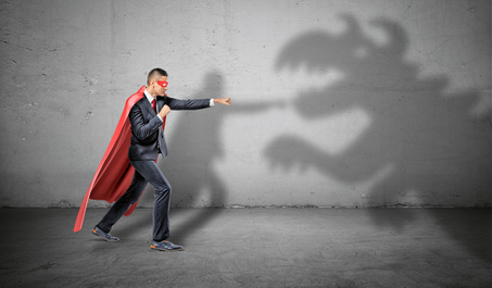 Am i a monster because I'm prejudice: A superhero businessman fighting off a dragon shadow on concrete background