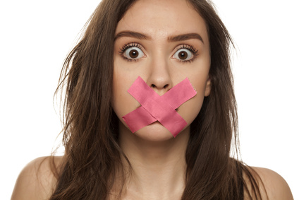 NDA: Woman's mouth being covered up by pink tape