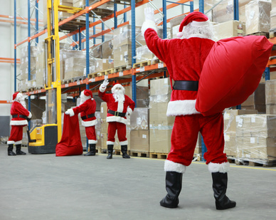 A positive culture can't survive if there is no sense of team: Santa Claus waving at his fellow colleges in a warehouse