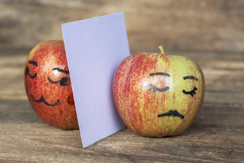 An apple with a sad face drawn on representing how to avoid historic grievance claims