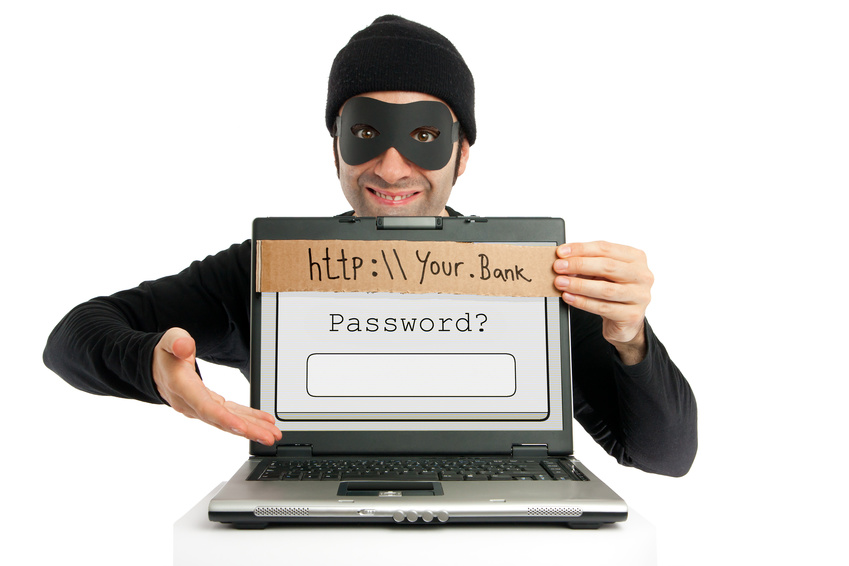 A thief (dressed in black and eye-masked) representing Cyber security