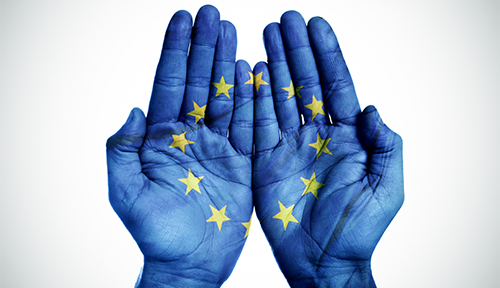 The new immigration rules for 2021 that UK employers need to know about: blue hands with EU flag painted on them
